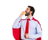 Businessman dressed like superhero eating an apple — Foto de Stock
