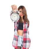 Girl holding a clock over white background — Stock Photo