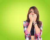 Frightened girl over green background. — Stock Photo