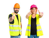 Workman with thumb up over white background — Foto de Stock