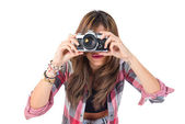 Pretty girl photographing over white background   — Stock Photo