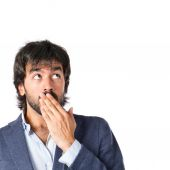 Man doing surprise gesture over white background — Stock Photo