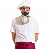 Crazy chef holding a clock over white background — Stock Photo