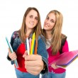 Students holding crayons over white background — Stock Photo #58485873