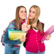 Students holding crayons over white background — Stock Photo #58485875