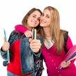 Students holding crayons over white background — Stock Photo #58485893