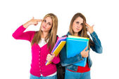 Student women making suicide gesture over white background   — Stock Photo