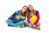 Students doing a joke over isolated white background — Stock Photo