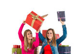 Christmas women holding gifts over white background — Stockfoto