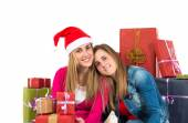 Christmas women holding gifts over white background — Foto Stock