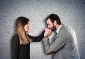 Man kissing a woman's hand over textured background  — Stock Photo
