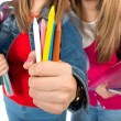 Students holding crayons over white background — Stock Photo #60525499
