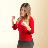 Young girl giving punch over isolated white background  — Foto de Stock