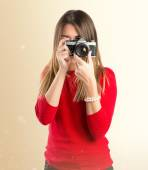 Girl taking a picture over white background  — Stock Photo