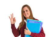 Student making Ok sign over white background — Stock Photo