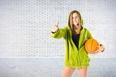 Young girl with thumb up over textured background — Stock Photo