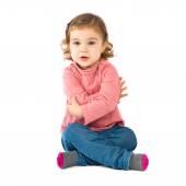 Little girl sitting over isolated white background — Foto de Stock