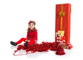 Little girl around christmas elements — Stock Photo