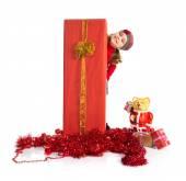 Little girl around christmas elements — Stock Photo