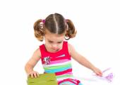 Kid holding a present over white background — Stock Photo