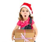 Surprised blonde christmas kid with a gift — Stock Photo