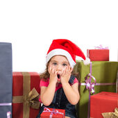 Blonde christmas kid around several presents doing surprise gest — Stock Photo