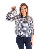 Woman holding vintage clock — Stock Photo