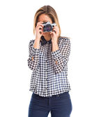 Woman photographing over white background — Stock Photo