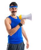 Sportman shouting by megaphone — Stock Photo
