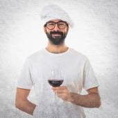Chef holding wine glass — Stock Photo