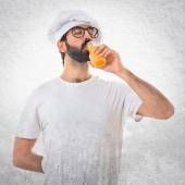 Chef drinking orange juice — Stock Photo