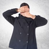 Man covering his face — Stock Photo