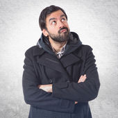 Man having doubts over white background — Stock Photo