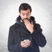Surprised man talking to mobile — Stock Photo