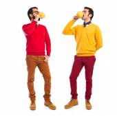Twin brothers holding cup of coffee — Stock Photo