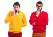 Twin brothers doing surprise gesture — Stock Photo
