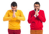 Twin brothers pleading over white background  — Stock Photo