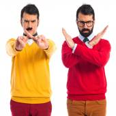 Twin brothers doing NO gesture — Stock Photo