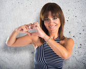 Woman making a heart with her hands — Stock Photo