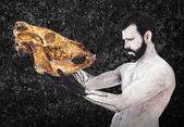 Förhistoriska människan söker kalvkött skalle — Stockfoto