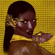 A beautiful young African woman wearing gold jewelry against a gold abstract background. A unique digital art creation of fashion and beauty. — Stock Photo #77156499