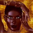 A beautiful young African woman wearing gold jewelry against a gold abstract background. A unique digital art creation of fashion and beauty in a vogue pose. — Stock Photo #77156539
