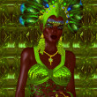 Carnival dancer woman in green feathers and headdress. — Stock Photo #77156669