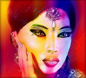 Abstract digital art of Indian or Asian woman's face, close up with colorful make up. An oil paint effect and glowing lights are added for a more modern art look and feel to this beauty and fashion scene. — Stock Photo