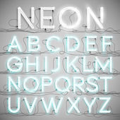Realistic neon alphabet with wires — Stock Vector