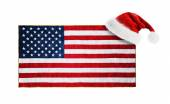 Santa Claus hat hung on the US flag — Stock Photo