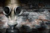 Gas mask shrouded in smoke — Stock Photo