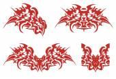 Flaming dragon head symbols — Stock Vector
