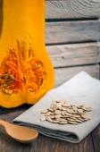 Pumpkin seeds and pumpkin — Stock Photo