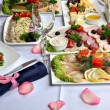 Beautifully decorated table, with meat and fish specialties. — Stock Photo #54253231